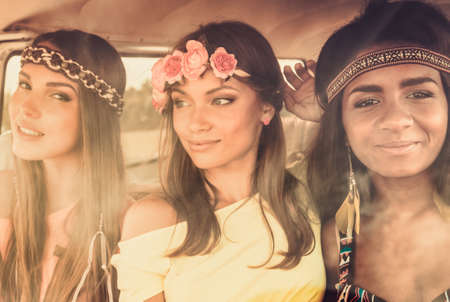 multinational: Multinational hippie girls in a van