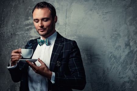 sharp: Sharp dressed fashionist with cup of coffee