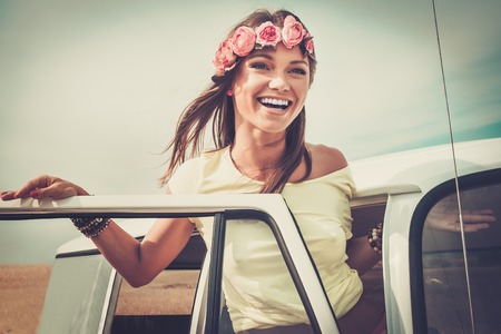 fit girl: Hippie girl in a van on a road trip Stock Photo