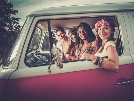 hippie: Multi-ethnic hippie friends on a road trip