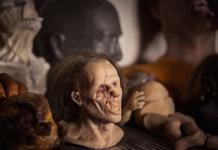 fx: Masks and dummies on a shelf in prosthetic special fx workshop