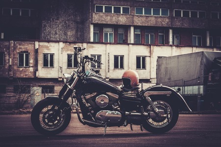 a motorcycle: Custom made bobber motorcycle on a road