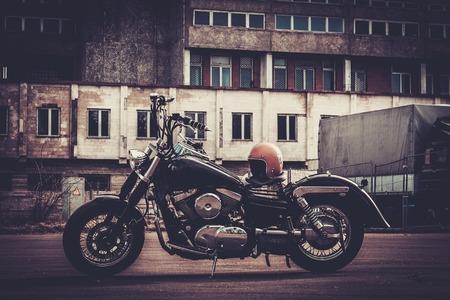 bobber: Custom made bobber motorcycle on a road
