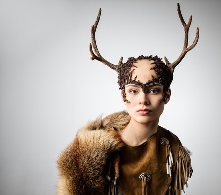 witchery: Mythical turnskin woman with deer antlers Stock Photo