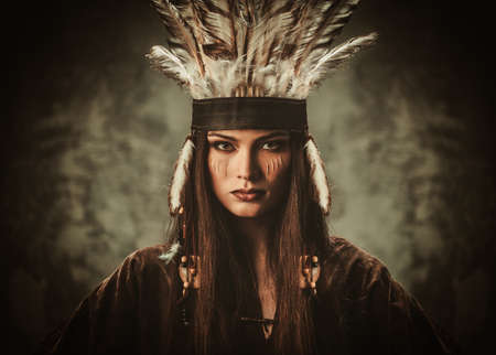 warrior girl: Woman in traditional indian garment and headdress