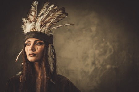 indian headdress: Woman with traditional indian headdress and face paint
