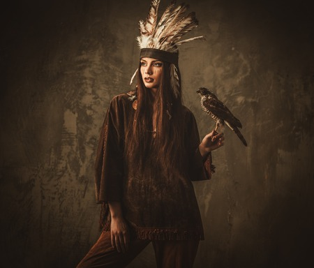 Indian woman hunter with  pet hawk