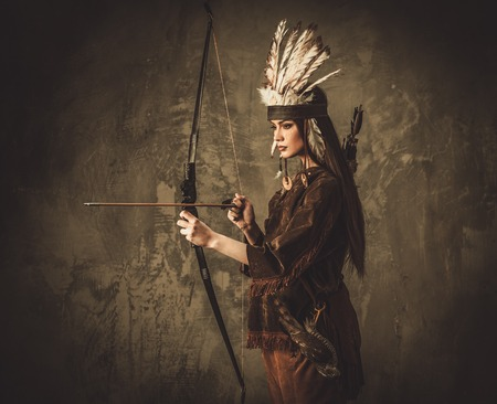 ceremonial clothing: Indian woman hunter with bow and prey bird