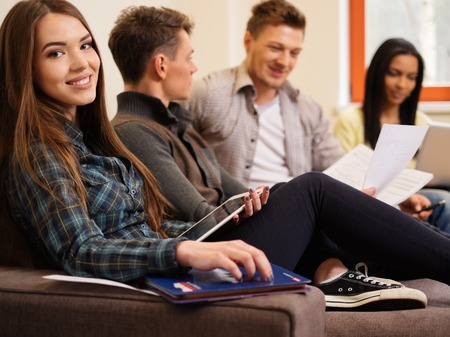exam: Group of students preparing for exams in apartment interior Stock Photo