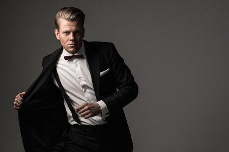 manly man: Sharp dressed man wearing jacket and bow tie
