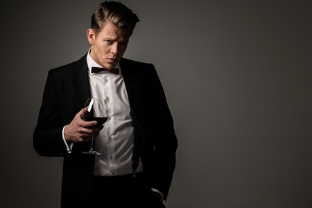 manly man: Confident sharp dressed man with glass of wine