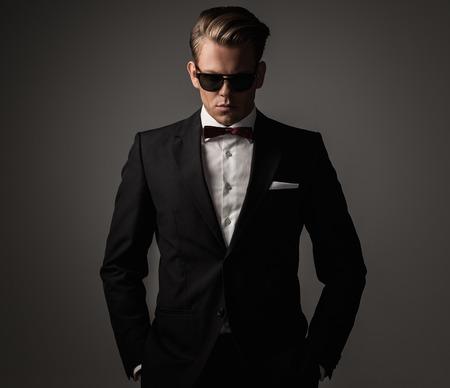 dandy: Confident sharp dressed man in black suit