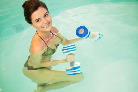 water aerobics: Woman on water aerobics workout Stock Photo