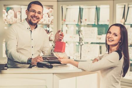 buyers: Happy woman customer in a jewellery shop