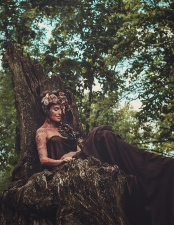 magical forest: Nymph sitting on her throne in a magical forest