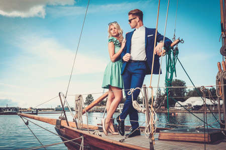 wealthy: Stylish wealthy couple on a luxury yacht