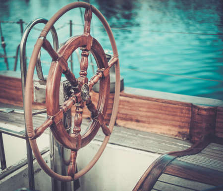 steer: Helm on a vintage wooden yacht