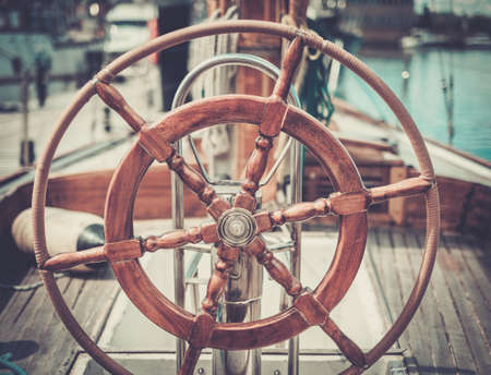 sailing ship: Helm on a vintage wooden yacht