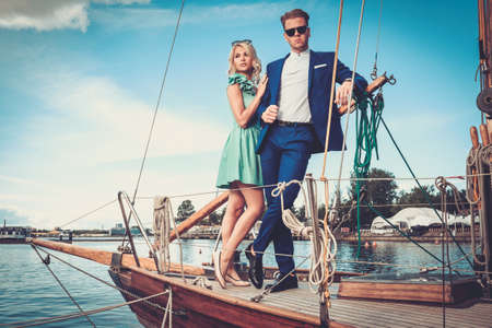 yacht people: Stylish wealthy couple on a luxury yacht