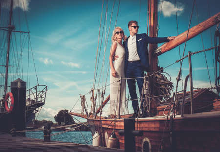 luxury lifestyle: Stylish wealthy couple on a luxury yacht