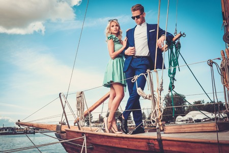 yachting: Stylish wealthy couple on a luxury yacht