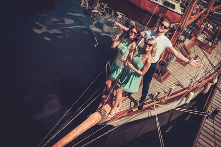 wealthy: Stylish wealthy friends having fun on a luxury yacht