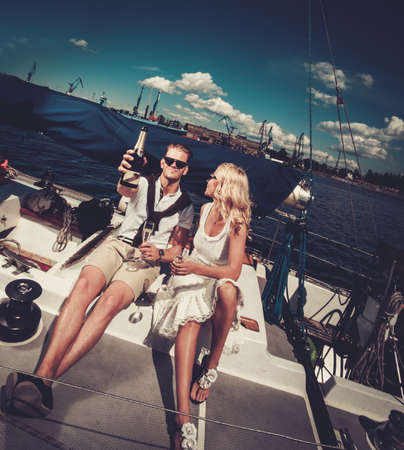 boat party: Stylish wealthy couple on a yacht Stock Photo