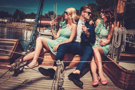 boat party: Stylish wealthy friends having fun on a luxury yacht