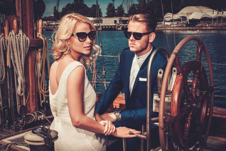 the yacht: Stylish wealthy couple on a luxury yacht