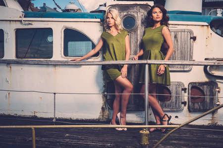 sail boat: Stylish women on old rusty boat