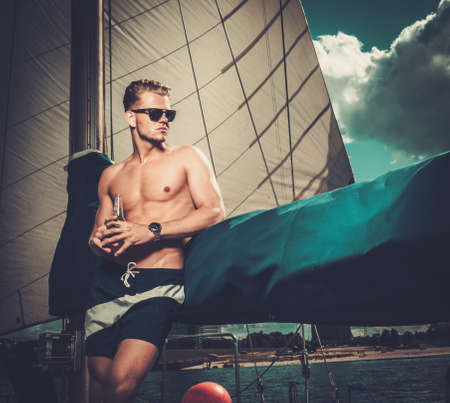 sail boat: Handsome man on a regatta