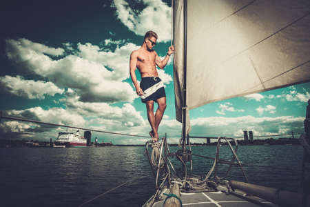 handsome man: Handsome man on a regatta