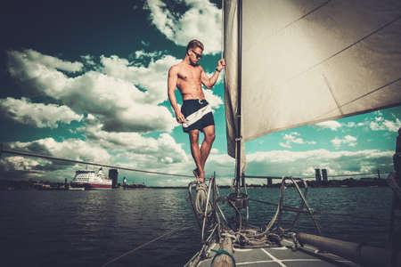 sailing crew: Handsome man on a regatta