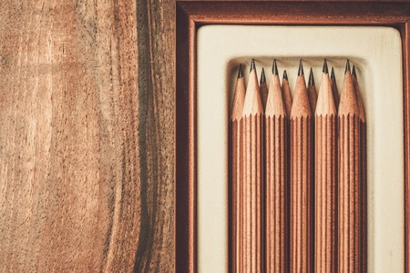 work table: Luxurious charcoal drawing pencils on a wooden table Stock Photo