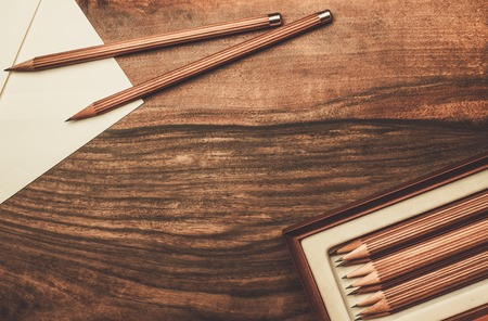 drawing table: Luxurious charcoal drawing pencils on a wooden table Stock Photo