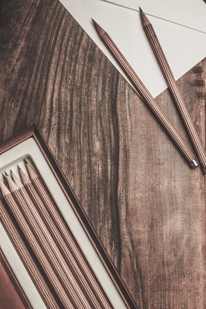 creative writer: Luxurious charcoal drawing pencils on a wooden table Stock Photo