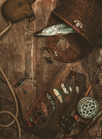 fishhook: Fishing tools and fresh pike on a wooden table Stock Photo