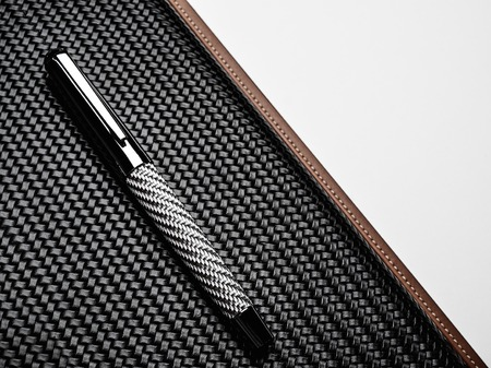 luxurious: Luxurious rollerball pen on a carbon surface Stock Photo