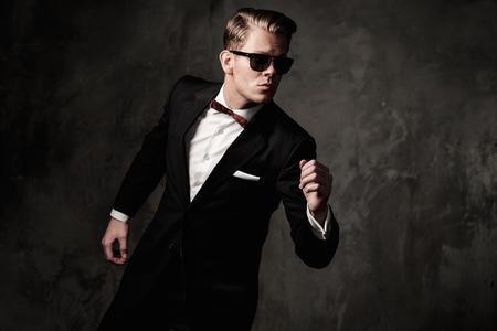 dressed: Tough sharp dressed man in black suit