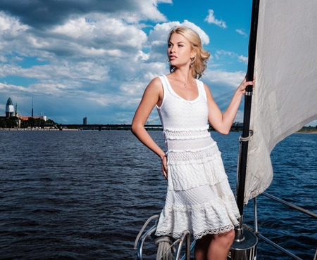 boat party: Stylish wealthy woman on a luxury yacht