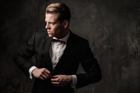 sharp: Tough sharp dressed man in black suit