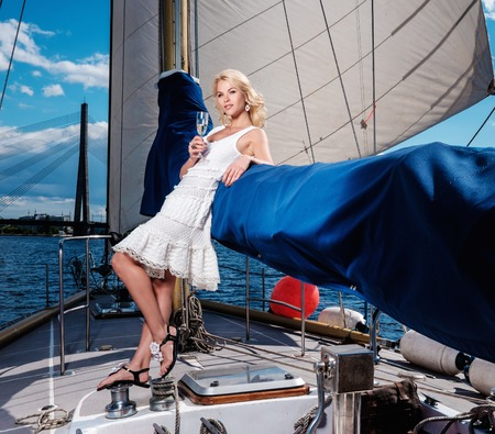 private party: Stylish wealthy woman on a luxury yacht