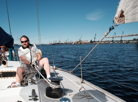 yacht people: Captain on a yacht during race
