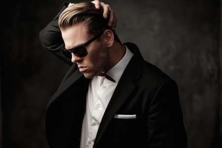 agents: Tough sharp dressed man in black suit
