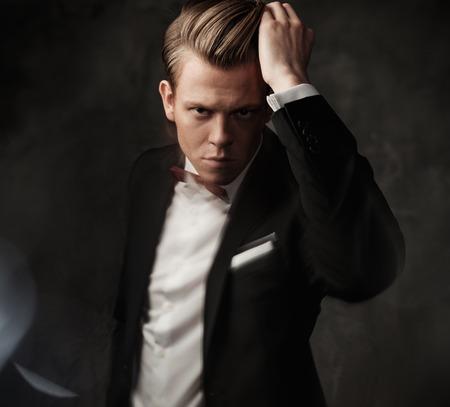 tough: Tough sharp dressed man in black suit