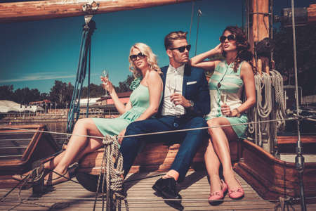 private party: Stylish wealthy friends having fun on a luxury yacht