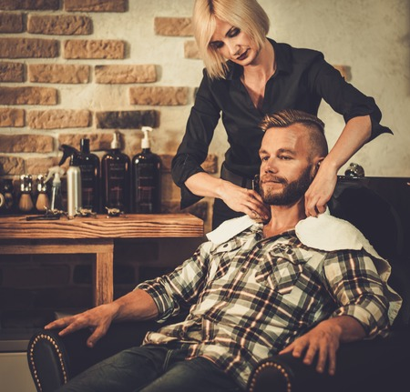 hairstylist: Hairstylist washing clients hair in barber shop