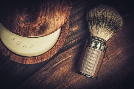 macho man: Shaving brush and soap on a luxury wooden background