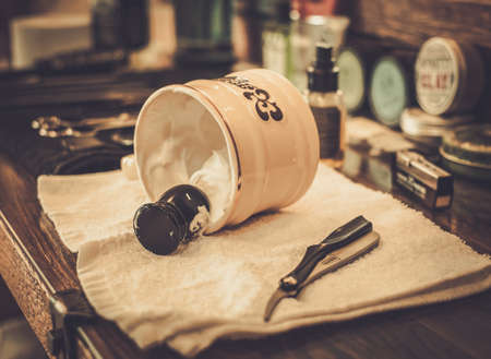 straight razor: Shaving accessories in barber shop