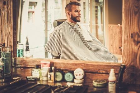 barber: Stylish man in a barber shop